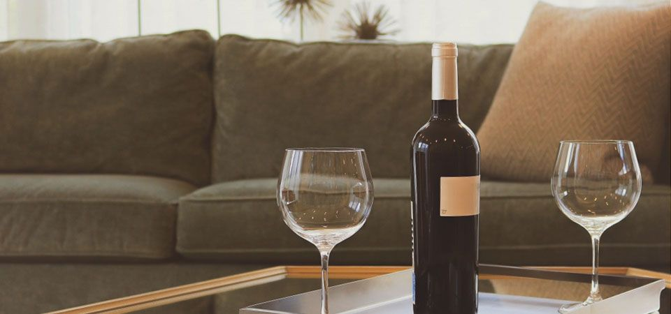 wine bottle and glasses for tasting at home