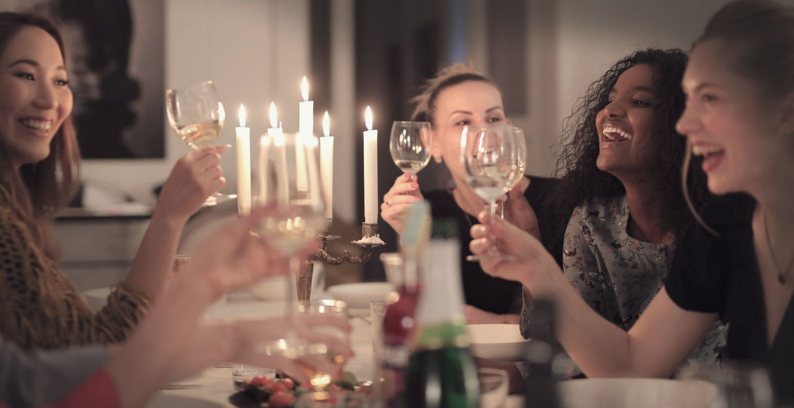 friends tasting wine at home
