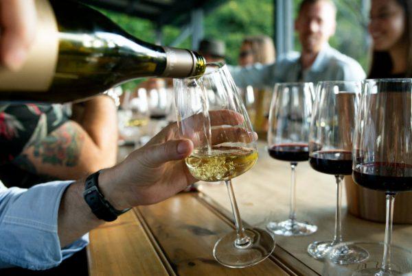 Customers Enjoying Wine at Bar