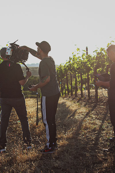 pour team at vineyard recording video